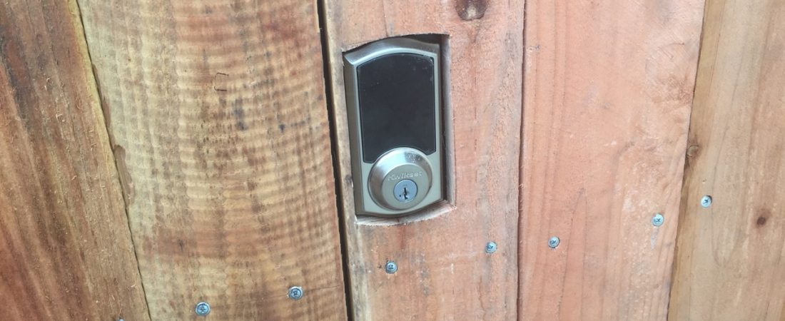 custom deadbolt lock installed on wood fence in los angeles california
